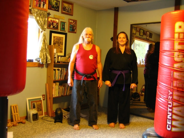 Here he is teaching free self defense in his home dojo, along with Amy. The day after her Kenpo Purple Belt test in 2018.